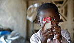 An internally displaced girl living in Segou, Mali, takes a photograph with her mobile phone.
