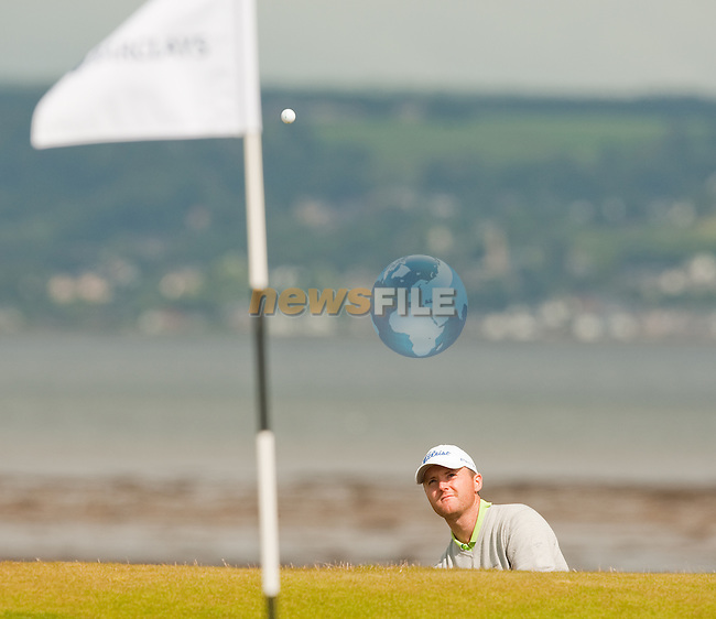 Michael Hoey pitches onto the 3rd green during the first days play of the Barclays Scottish Open, played over the links at Castle Stuart, Inverness, Scotland from 7th to 10th July 2011:  Picture Stuart Adams /www.golffile.ie  7th July July 2011