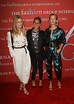 Left to right model IAnna Ewers, designer Isabel Marant and model Carolyn Murphy arrive at The Fashion Group International's Night of Stars 2017 gala at Cipriani Wall Street on October 26, 2017.
