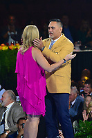 Canton, Ohio - August 2, 2019:  Kevin Mawae receives his Hall of Fame Gold Jacket from his wife at the Canton Civic Center in Canton, Ohio August 2, 2019.  (Photo by Don Baxter/Media Images International)