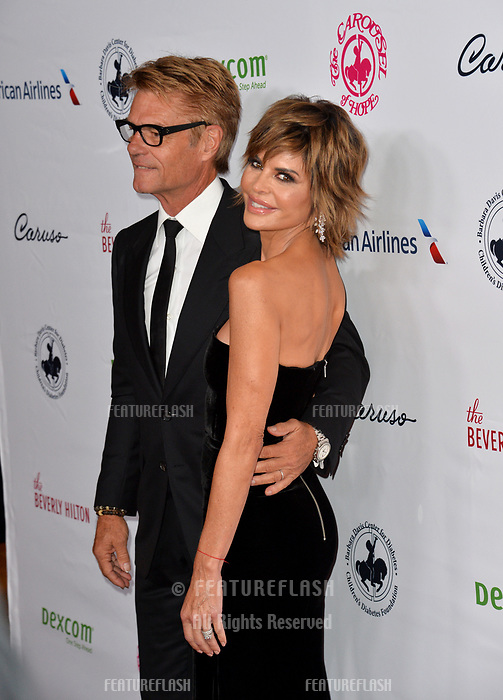 LOS ANGELES, CA. October 06, 2018: Harry Hamlin &amp; Lisa Rinna  at the 2018 Carousel of Hope Ball at the Beverly Hilton Hotel.<br /> Picture: Paul Smith/Featureflash