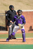 High Point Panthers catcher Josh Spano (21) on defense against the UNCG Spartans at Willard Stadium on February 14, 2015 in High Point, North Carolina.  The Panthers defeated the Spartans 12-2.  (Brian Westerholt/Four Seam Images)