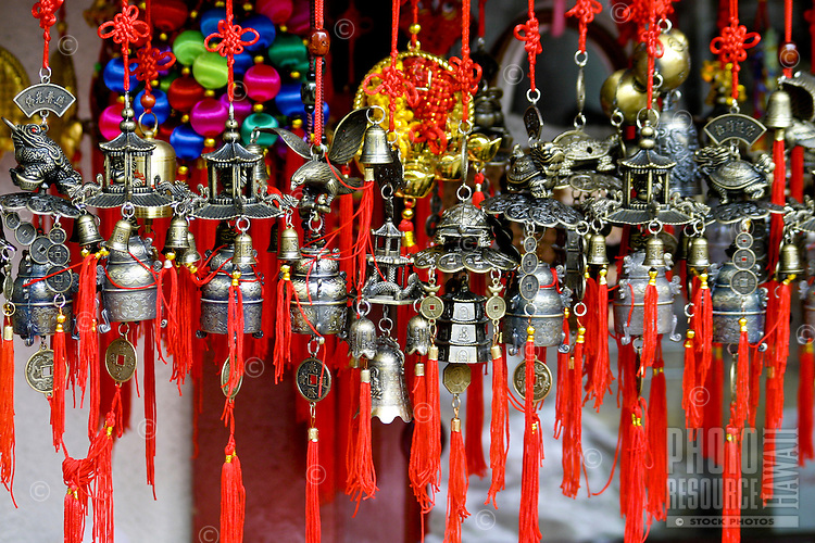 Colorful chinese ornaments adorn many storefront windows in Chinatown, downtown Honolulu, Oahu