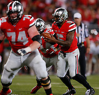 Ohio State Buckeyes quarterback Braxton Miller (5) prepares to hand off the ball during Saturday's NCAA Division I football game against Wisconsin at Ohio Stadium in Columbus on September 28, 2013. (Barbara J. Perenic/Columbus Dispatch)
