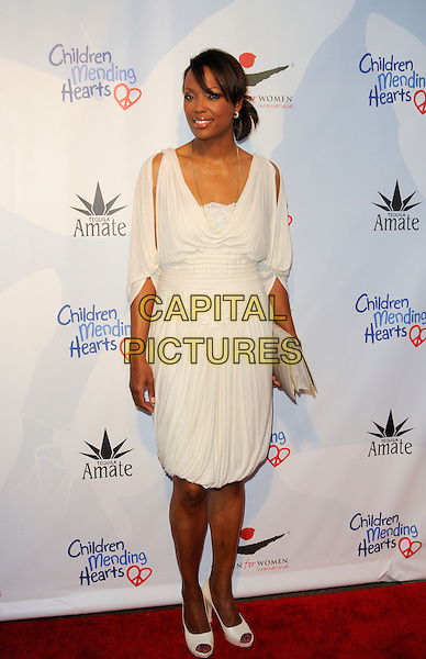 "AISHA TYLER.arriving at Children Mending Hearts' 3rd Annual ""Peace Please"" Gala at the Music Box @ Fonda in Hollywood, California, USA, April 16th, 2010.  .arrivals full length white cream dress clutch bag peep toe shoes slit slits sleeves draped grecian .CAP/ROT.©Lee Roth/Capital Pictures"