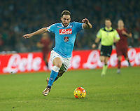 Napoli's Gonzalo Higuain  controls the ball during the  italian serie a soccer match,between SSC Napoli and AS Roma       at  the San  Paolo   stadium in Naples  Italy ,December 13, 2015
