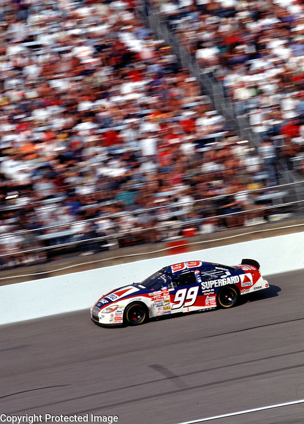 Jeff Burton races down the frontstretch during the Popsecret 400 at Rockingham, NC in October 2000. (Photo by Brian Cleary)