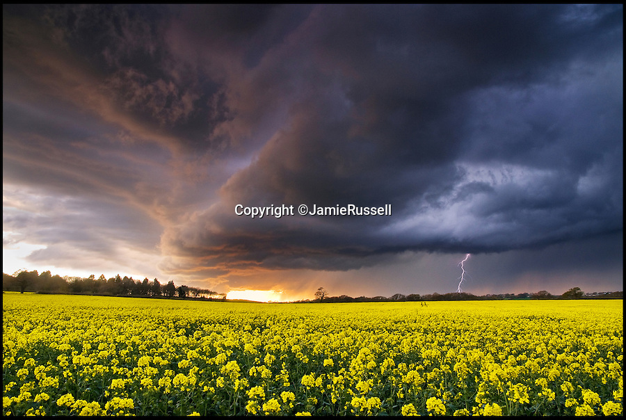 BNPS.co.uk (01202 558833)<br /> Pic: JamieRussell/BNPS<br /> <br /> ***Please Use Full Byline***<br /> <br /> An evening storm collects over Ashey.<br /> <br /> Stunning photographs have revealed a turbulent side to the normally genteel Isle of Wight.<br /> <br /> The seemingly benign south coast holiday destination has been catalogued over a stormy year by local photographer Jamie Russell, and his astonishing pictures reveal the dramatic changes in weather that roll across the UK in just 12 months.<br /> <br /> Lightning storms, ice, floods, gales and blizzards have all been captured by the intrepid photographer who frequently got up in the middle of the night to capture the climatic chaos.<br /> <br /> Looking at these pictures prospective holidaymakers could be forgiven for thinking twice about a gentle staycation on the south coast island.