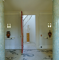 The red entrance door to the apartment opens on to a hall with a black and white marble mosaic floor which depicts the adventures of Odysseus