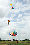 CHAD PILSTER &bull;&nbsp;Hays Daily News<br /> <br /> Isiah Shuler, 9, plays around with some giant kites on Wednesday, June 19, 2013, near the 2500 Block of 13th St. in Hays, Kansas. David Burroughs has giant kites which he bought in Oregon, but likes to fly in Kansas because it is so windy. He regularly passes through Hays twice a year as he moves between Nevada and Virginia.