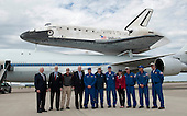 NASA Deputy Administrator Lori Garver, fourth from right, stands with the crew of 747 Shuttle Carrier Aircraft (SCA) along with other officials from the Smithsonian Institution, along with United States Senator Patrick Leahy (Democrat of Vermont), fourth from left, in front of Space Shuttle Discovery following its landing at Washington Dulles International Airport, Tuesday, April 17, 2012, in Sterling, Va. Photo Mandatory Credit: Mark Avino / NASA-Smithsonian Institution via CNP