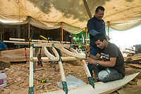 NWA Democrat-Gazette/BEN GOFF @NWABENGOFF<br /> Paul Beasa (fore) and Waiston Beaja (CQ) work on lashing together supports for the outrigger Wednesday, May 9, 2018, while working on the Marshallese Korkor at the Shiloh Museum of Ozark History in Springdale. Master canoe builder Liton Beasa and his family, in partnership with the Shiloh Museum of Ozark History, began building the two-man Marshallese canoe called a KorKor April 14 and plan to display the finished canoe at the Little Craft Show Saturday in downtown Springdale.