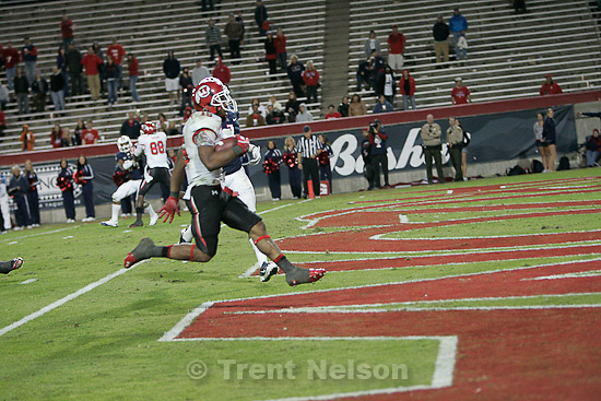Trent Nelson  |  The Salt Lake Tribune.With a scattering Arizona crowd in the background, Utah's John White runs into the end zone for a second half touchdown as Utah faces Arizona, college football at Arizona Stadium in Tucson, Arizona, Saturday, November 5, 2011.