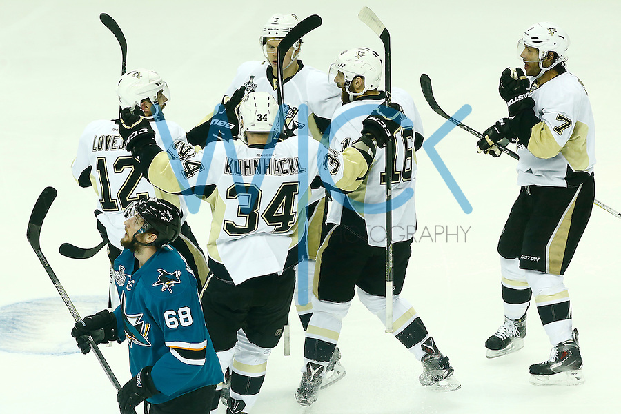 Ben Lovejoy #12 of the Pittsburgh Penguins is congratulated by teammates following his first period goal against the San Jose Sharks during game three of the Stanley Cup Final at the SAP Center in San Jose, California on June 4, 2016. (Photo by Jared Wickerham / DKPS)