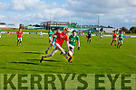 Anthony Darmody of East Kerry on the attack as Josh O'Keefe of St Kierans bears down on him, in the Minor County Football Championship Final on Sunday.
