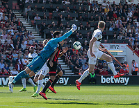 Fulham's Sergio Rico (left) battles with Bournemouth's Callum Wilson (centre) as he punches the ball clear<br /> <br /> Photographer David Horton/CameraSport<br /> <br /> The Premier League - Bournemouth v Fulham - Saturday 20th April 2019 - Vitality Stadium - Bournemouth<br /> <br /> World Copyright © 2019 CameraSport. All rights reserved. 43 Linden Ave. Countesthorpe. Leicester. England. LE8 5PG - Tel: +44 (0) 116 277 4147 - admin@camerasport.com - www.camerasport.com