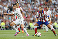 James of Real Madrid and Koke of Atletico de Madrid during La Liga match between Real Madrid and Atletico de Madrid at Santiago Bernabeu stadium in Madrid, Spain. September 13, 2014. (ALTERPHOTOS/Caro Marin)