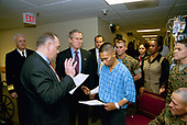 United States President George W. Bush attends the U.S. Citizenship Ceremony for Marine Corps Lance Cpl. O.J. Santamaria of Daly City, California, at the National Naval Medical Center in Bethesda, Maryland, Friday, April 11, 2003.<br /> Mandatory Credit: Eric Draper / White House via CNP