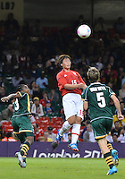 July 31, 2012..Japan's Megumi Takase (15), South Africa's Nothando Vilakazi (3) and Janine Van Wyk in action during Group F women's Football match between JPN and RSA at the Millennium Stadium on day four of 2012 Olympic Games in Cardiff, United Kingdom...
