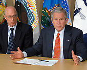 Washington, D.C. - July 11, 2008 -- United States Secretary of the Treasury Henry Paulson looks on from left as United States President George W. Bush meets with members of his Economic Team to look for ways to lessen the impact of high gasoline and energy prices on American consumers and businesses at the United States Department of Energy in Washington, DC on Friday, July 11, 2008.  He also spoke concerning discussions about the problems of mortgage lenders Freddie Mac and Fannie Mae.<br /> Credit: Ron Sachs / Pool via CNP