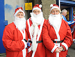 mary Hoey, Patricia Malone and Ann Malone who took part in the Santa Dash. Photo: Colin Bell/pressphotos.ie
