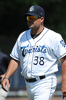 Asheville Tourists pitching coach Joey Eischen #38 during  a  game  against the Hickory Crawdads at McCormick Field on August 7, 2011 in Asheville, North Carolina. Hickory won the game 16-6.   (Tony Farlow/Four Seam Images)
