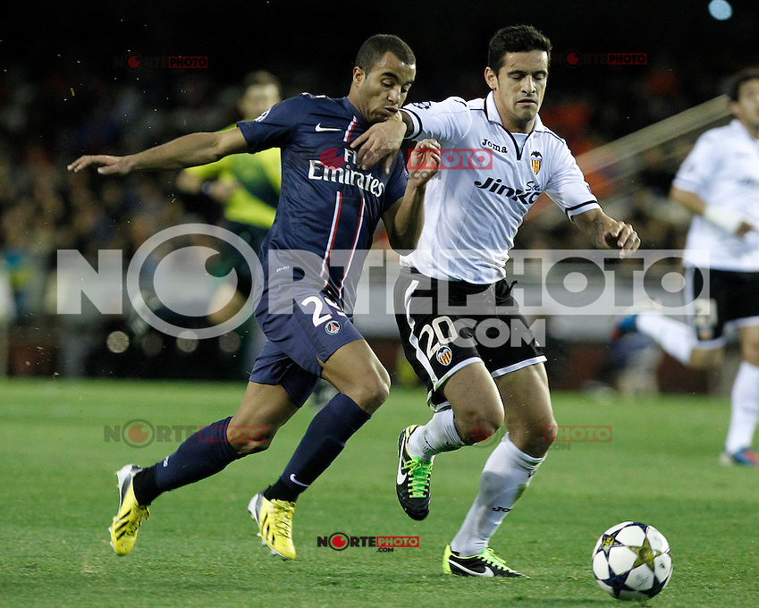 Valencia CF's Ricardo Costa (r) and Paris Saint-Germain's Lucas during Champions League 2012/2013 match.February 12,2013. (ALTERPHOTOS/Acero) /NortePhoto