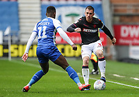 Bolton Wanderers' Andrew Taylor competing with Wigan Athletic's Gavin Massey <br /> <br /> Photographer Andrew Kearns/CameraSport<br /> <br /> The EFL Sky Bet Championship - Wigan Athletic v Bolton Wanderers - Saturday 16th March 2019 - DW Stadium - Wigan<br /> <br /> World Copyright &copy; 2019 CameraSport. All rights reserved. 43 Linden Ave. Countesthorpe. Leicester. England. LE8 5PG - Tel: +44 (0) 116 277 4147 - admin@camerasport.com - www.camerasport.com