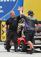 Jun 17, 2017; Bristol, TN, USA; NHRA pro mod driver Shane Molinari (left) celebrates with a crew member during qualifying for the Thunder Valley Nationals at Bristol Dragway. Mandatory Credit: Mark J. Rebilas-USA TODAY Sports
