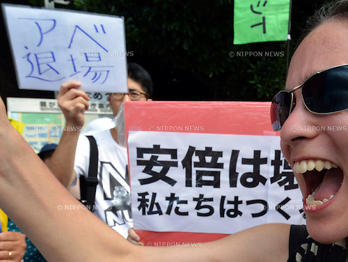 """July 1, 2014, Tokyo,Japan - Carrying placards and banners, thousands of protesters gather outside Prime Minister Shinzo Abe's office in Tokyo to show their opposition to a historic move to lift a self-imposed ban on exercising the right to collective self-defense on Tuesday, July 1, 2014. Abe's Cabinet is set to approve a reinterpretation of Article 9 of the nation's U.S.-drafted post-World War II constitution, which renounces war. Under the new rules, Japan's military would be allowed to exercise the right to """"collective self-defense."""" The change is intended to allow Japan to defend friendly nations that come under attack.  (Photo by Natsuki Sakai/AFLO)"""