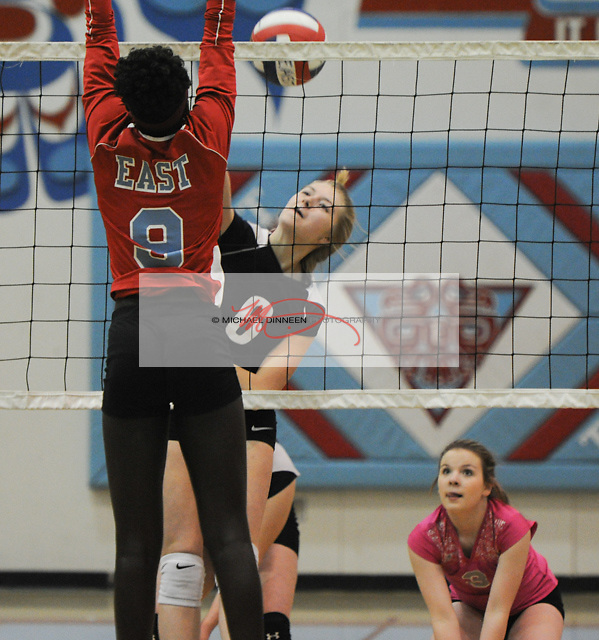 Eagle River's Klyie Trout makes a shot as Kaylee Barch looks on in their match with East High Thursday, October 14, 2016.  Photo for the Star by Michael Dinneen
