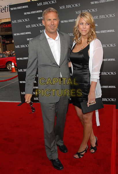 """KEVIN COSTNER & CHRISTINE BAUMGARTNER.attends The L.A. Premiere of """"Mr. Brooks"""" held at .The Grauman's Chinese Theater in Hollywood, California,.USA, May 22nd 2007..full length grey suit white shirt black dress strappy shoes.CAP/DVS.©Debbie VanStory/Capital Pictures"""