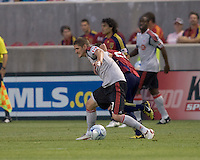 Toronto FC midfielder Carl Robinson (33) fends off Real Salt Lake midfielder Ned Grabavoy (20). Salt Lake Real defeated Toronto FC, 3-0, at Rio Tinto Stadium on June 27, 2009.
