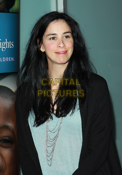 "SARAH SILVERMAN.Alliance For Children's Rights ""Right To Laugh"" Fundraiser  held at the Catalina Jazz Club, Hollywood, California, USA..March 15th, 2010.half length top cardigan black green striped stripes grey gray silver necklace smiling .CAP/ADM/TC.©T. Conrad/AdMedia/Capital Pictures."