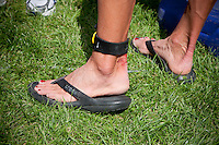 Chrissie Wellington's feet just after winning first place for women at the Challenge Roth Ironman Triathlon, Roth, Germany, 10 July 2011. The obligatory timing device worn rubbed her ankle during the race.