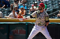 Ian Stewart (4) of the Salt Lake Bees at bat against the Fresno Grizzlies at Smith's Ballpark on May 26, 2014 in Salt Lake City, Utah.  Stewart, from the Los Angeles Angels of Anaheim was in the lineup for a rehab stint with the Bees.  (Stephen Smith/Four Seam Images)