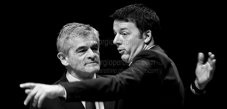 Matteo Renzi gestures during his speech close to Piedmont Governor Sergio Chiamparino at a political campaign convention of Partito Democratico - the Italian left-wing Party - for the Italian government elections in Turin, April 12, 2014.