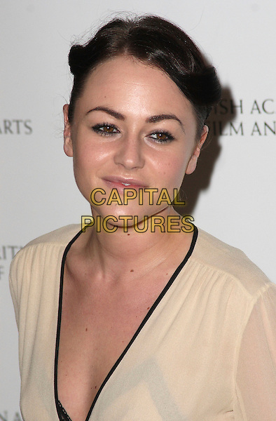 JAIME WINSTONE .2009 British Academy Television Craft Awards  at the London Hilton Hotel, London, England, UK, .May 17th 2009..Bafta Baftas TV Bafta's portrait headshot Jamie hair up cream black trim  eyeliner make-up twists twisted .CAP/JIL.©Jill Mayhew/Capital Pictures