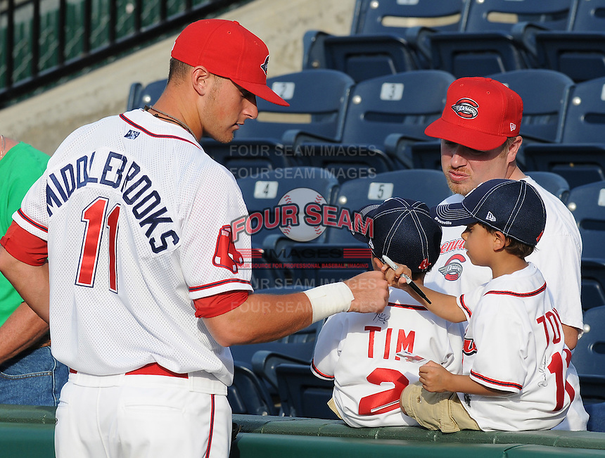 April 30, 2009: A young boy gets a fist bump from Greenville Drive plater Will Middlebrooks (11) prior to a game at Fluor Field at the West End in Greenville, S.C. Photo by: Tom Priddy/Four Seam Images