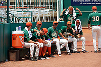 Greensboro Grasshoppers pitchers Vincenzo Aiello (standing), Manuel Rodriguez (19), Nestor Bautista (39), and Colton Hock (40) in the bullpen before a game against the Lakewood BlueClaws on June 10, 2018 at First National Bank Field in Greensboro, North Carolina.  Lakewood defeated Greensboro 2-0.  (Mike Janes/Four Seam Images)