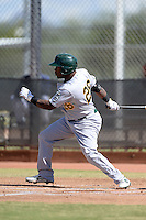 Oakland Athletics outfielder B.J. Boyd (26) during an Instructional League game against the Milwaukee Brewers on October 10, 2013 at Maryvale Baseball Park Training Complex in Phoenix, Arizona.  (Mike Janes/Four Seam Images)