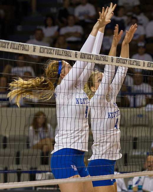 Senior Ashley Frazier and Freshman Sara Schwarzwalder protect against the kill at the net in Lexington, Ky., on Wednesday, September, 26, 2012. Photo by James Holt | Staff