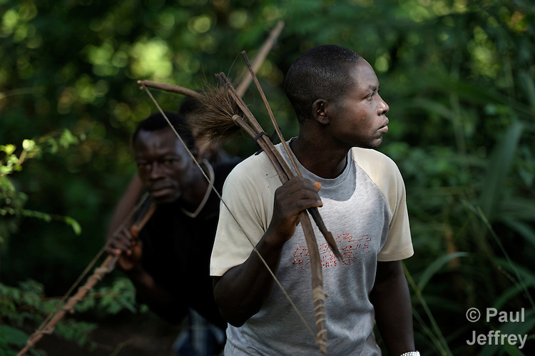Simon Peter Gamana (right) and Charles Gorden patrol the forest near their village of Riimenze, in Southern Sudan's Western Equatoria State, on the look out for the Lord's Resistance Army, which has displaced tens of thousands in recent months along the border area. Many believe the northern Sudan government is behind the attacks in its desire to destabilize the south in the period leading to a January 2011 referendum on secession. NOTE: In July 2011 Southern Sudan became the independent country of South Sudan.