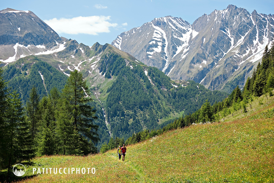 Couple hiking the Pfunderer Hohenweg from Bruneck to Sterzing in Italy's Sud Tirol Region, through the Zillertal Alpen