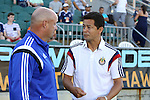 14 June 2014: Carolina head coach Colin Clarke (NIR) (left) and Chivas USA head coach Wilmer Cabrera (COL) (right) before the game. The Carolina RailHawks of the North American Soccer League played Chivas USA of Major League Soccer at WakeMed Stadium in Cary, North Carolina in the fourth round of the 2014 Lamar Hunt U.S. Open Cup soccer tournament. The RailHawks advanced by winning a penalty kick shootout 3-2 after the game had ended in a 1-1 tie after overtime.