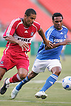 Aug 22 2007:  C.J. Brown (left) of the Fire moves the ball past Scott Sealy (19) of the Wizards.  The MLS Kansas City Wizards defeated the visiting Chicago Fire 3-2 at Arrowhead Stadium in Kansas City, Missouri, in a regular season league soccer match.