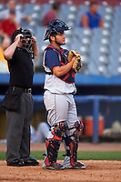 Brooklyn Cyclones catcher Jose Garcia (4) and umpire Donnie Smith during the first game of a doubleheader against the Connecticut Tigers on September 2, 2015 at Senator Thomas J. Dodd Memorial Stadium in Norwich, Connecticut.  Brooklyn defeated Connecticut 7-1.  (Mike Janes/Four Seam Images)