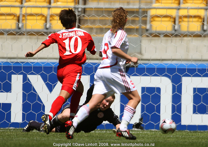 Korea's Hyong Hwa Jon closes in on her first goal as Denmark keeper Lene Gissel scrambles for her spilled ball during the FIFA Women's Under-17 World Cup pool match between Denmark and Korea DPR at Westpac Stadium, Wellington, New Zealand on Saturday, 8 November 2008. Photo: Dave Lintott / lintottphoto.co.nz