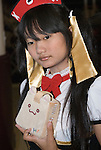 Asian girl dressed in Cosplay outfit