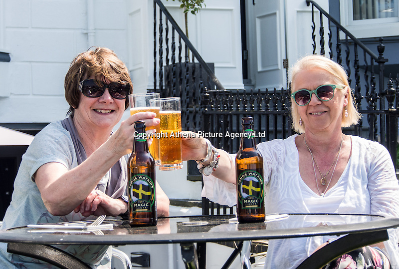 UK Weather: Aberystwyth, Ceredigion, West Wales Thursday 12th May 2016. <br />Two women enjoy a drink at a beer garden for a quite drink.